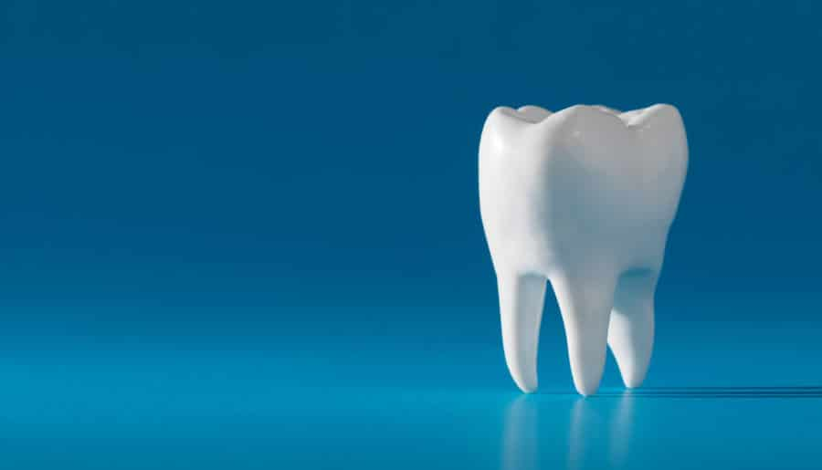 Dentistry Conceptual image | Tooth on Blue Background
