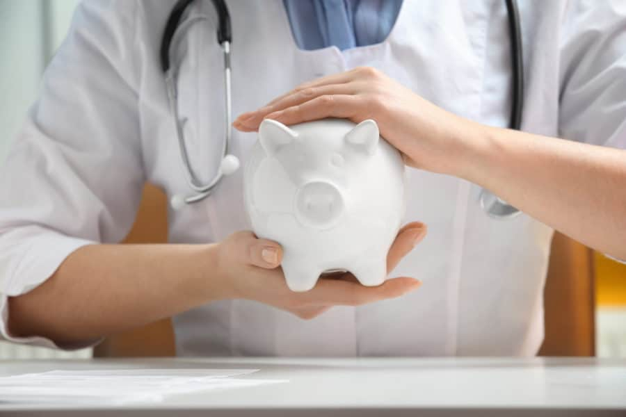Female Doctor With Piggy Bank Symbolizing Hospital Indemnity Insurance provides reimbursement for Hospital Stays