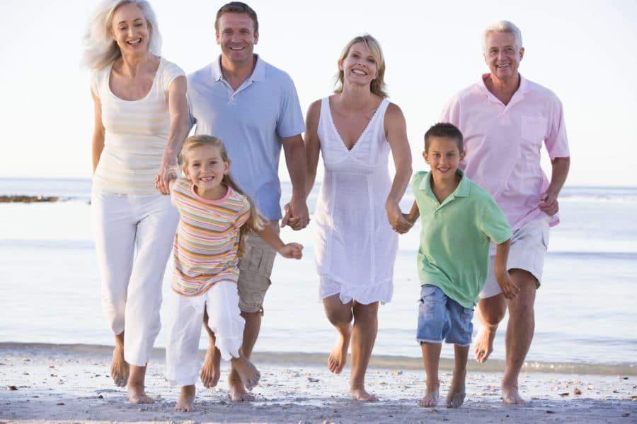 Extended Family Walking On Beach